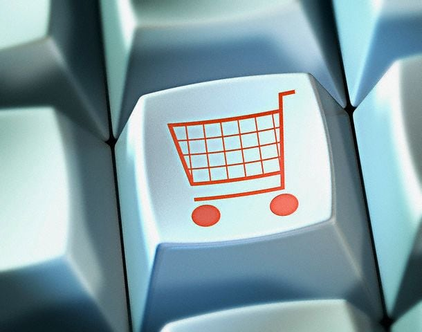 Shopping trolley on button of computer keyboard